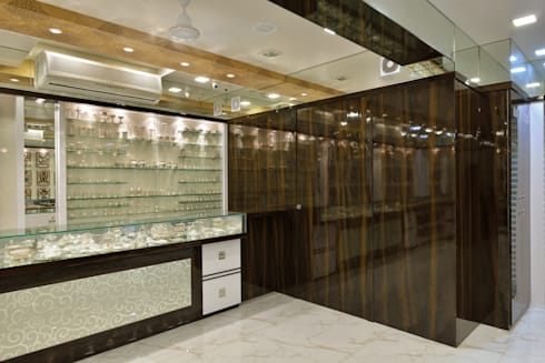 Retail Showroom:  Office spaces & stores  by Mykraaft Designers and Project consultants Private Limited