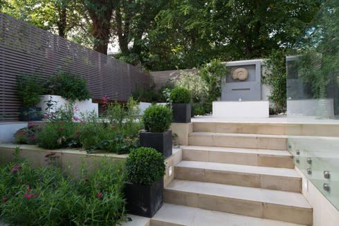 Garden: modern Garden by DDWH Architects