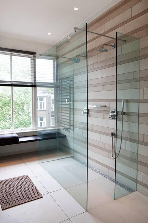 Baños de estilo  de Binnenvorm