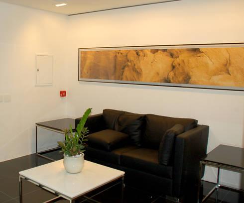 Recepção AGN: Espaços comerciais  por Peixoto Arquitetos Associados
