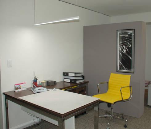 Secretaria: Espaços comerciais  por Peixoto Arquitetos Associados
