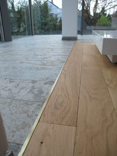 Projekty,  Ściany zaprojektowane przez Hammer & Margrander Interior GmbH