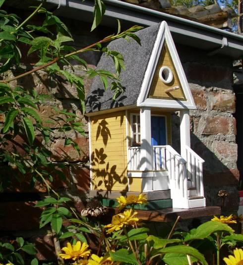 vogelhausmodelle: landhausstil Garten von holzwerkstatt-manfred berger
