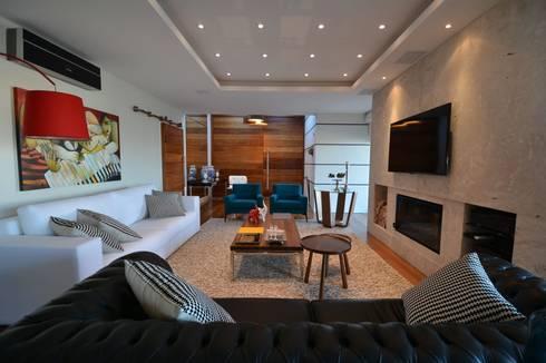 Sofás e poltronas: Salas de estar modernas por ARQ Ana Lore Burliga Miranda