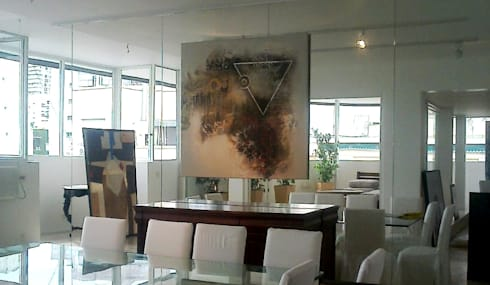 espacios con arte: Comedores de estilo moderno por Daniel Vidal