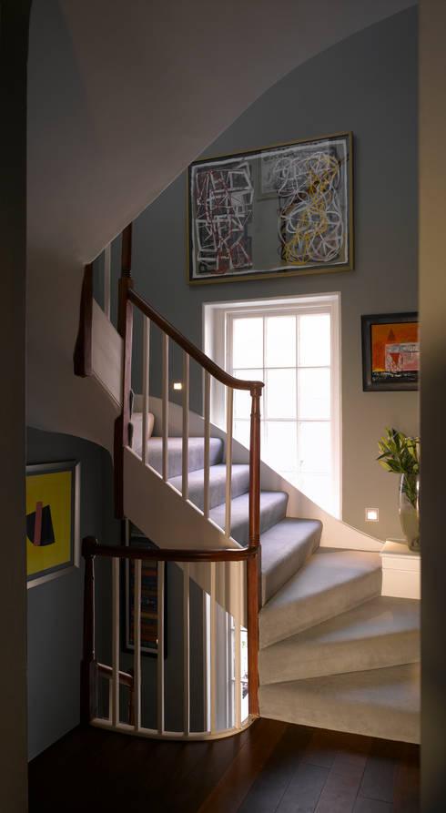 Park Village West:  Corridor & hallway by Belsize Architects