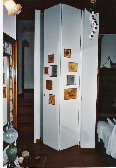Porte interne: Finestre & Porte in stile in stile Classico di Falegnameria Martinelli Sergio