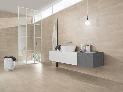 Wildwood: Casas de banho industriais por Love Tiles