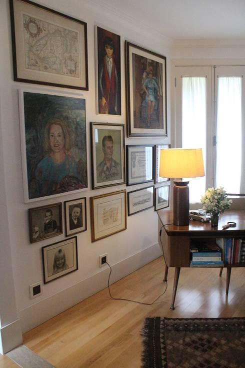 Residência Estilo Europeu: Escritório e loja  por Saly Gignon