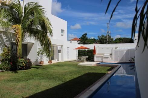 Casa habitacion en en Cozumel Quintana Roo: Casas de estilo minimalista por A2 HOMES SA DE CV