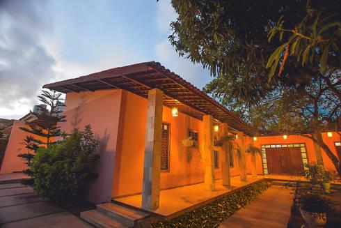 Casa Mariana: Casas rústicas por Martins Lucena Arquitetos