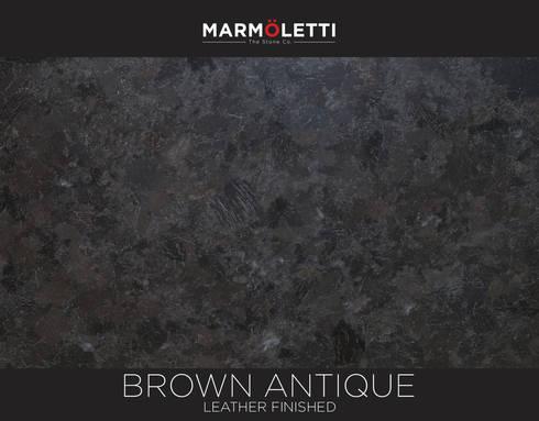 Granito Brown Antique: Cocinas de estilo moderno por MARMÖLETTI