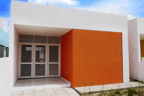 Cidade Feliz A: Casas minimalistas por Martins Lucena Arquitetos