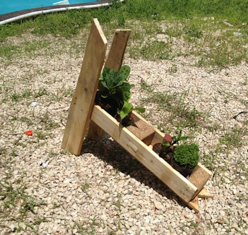 Jardinera sobreciclada de tarimas: Arte de estilo  por Punto Libre Arquitectura