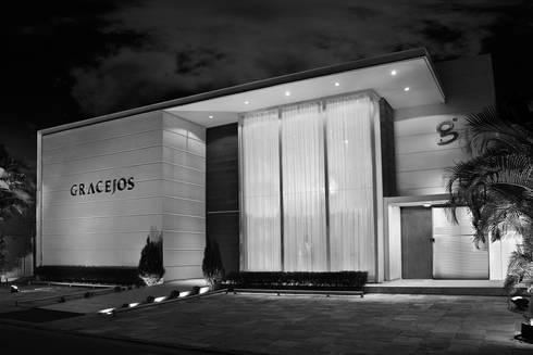 Gracejos Recepções: Casas modernas por Martins Lucena Arquitetos