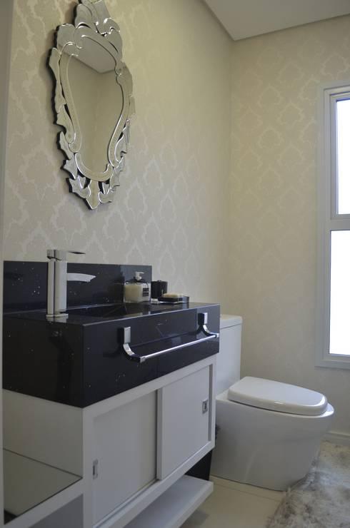 Lavabo luxo: Banheiros ecléticos por Ésse Arquitetura e Interiores