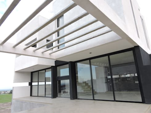 Casa LL: Terrazas de estilo  por jose m zamora ARQ