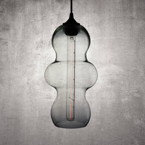 Tamarindo Transparente : Salas multimedia de estilo moderno por Luminosa ™
