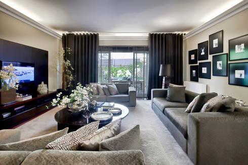Residência Foz: Salas de estar modernas por Jorge Cassio Dantas Lda