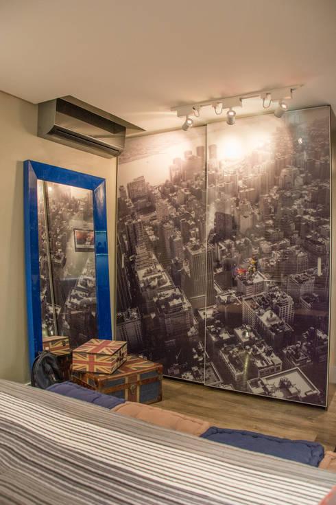 quarto de adolescente fotografo: Quartos  por Michele Moncks Arquitetura
