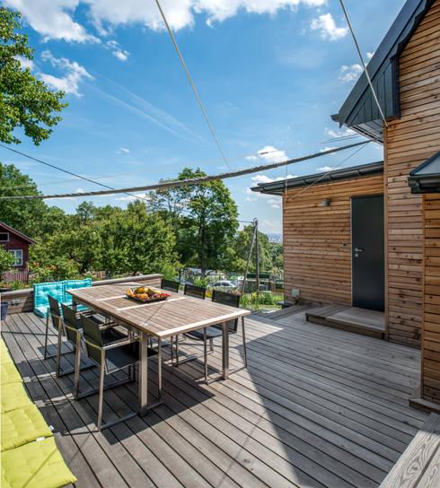 Wohnen im Sommerhause:  Häuser von UNA plant