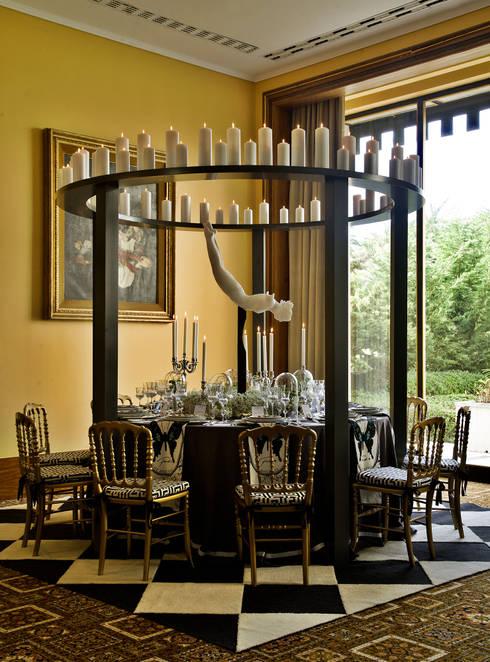 Dining room by Critério Arquitectos by Canteiro de Sousa