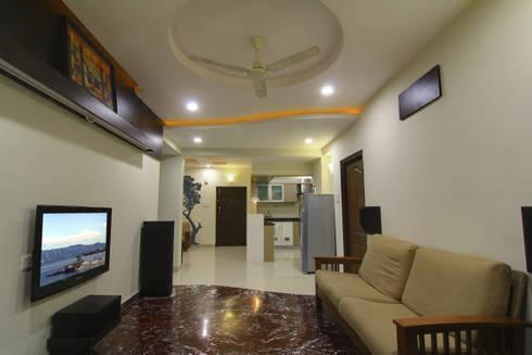 Hall cum mini Home Theatre:  Corridor & hallway by KREATIVE HOUSE