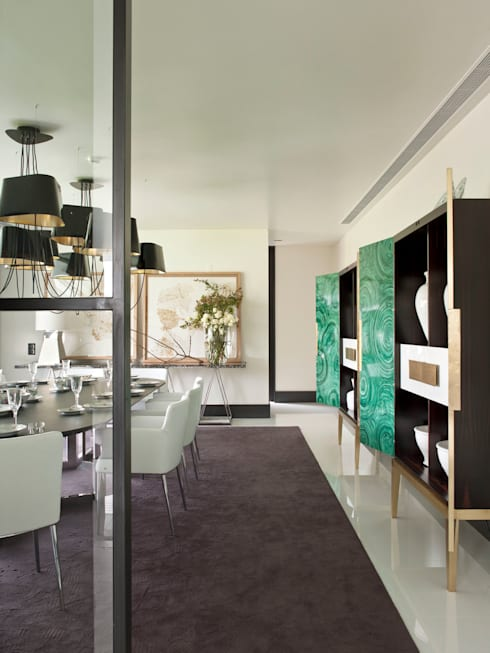 MODERN&DARING: Salas de jantar modernas por SA&V - SAARANHA&VASCONCELOS