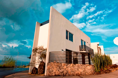 Fachada día : Casas de estilo minimalista por JF ARQUITECTOS
