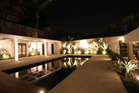 Iluminação: Jardins tropicais por HZ Paisagismo