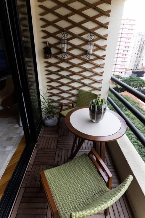 Varanda com frescor: Terraços  por MIS Arquitetura e Interiores