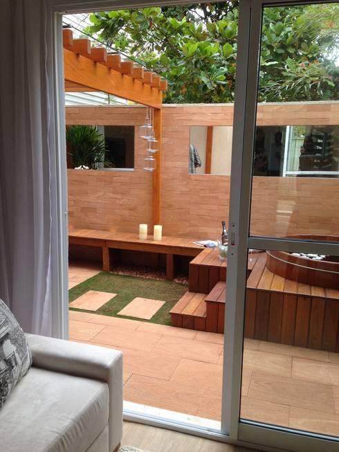 Condomínio Terrara: Terraços  por Gigi Gorenstein Arquitetura e Interiores