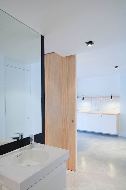 apartamento en edificio manigua: Baños de estilo  de Esteban Rosell