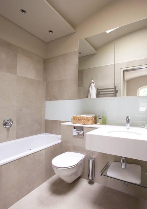 AFTER:  Bathroom by FALCHI INTERIORS LTD