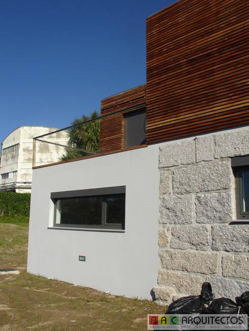 CASA OLI: Casas rústicas por AAC ARQUITECTOS