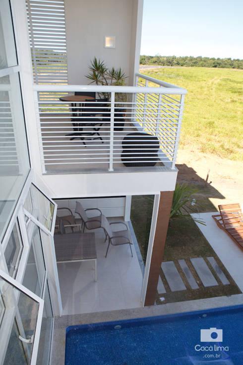 Casa : Casas modernas por Livia Tavares - Homify