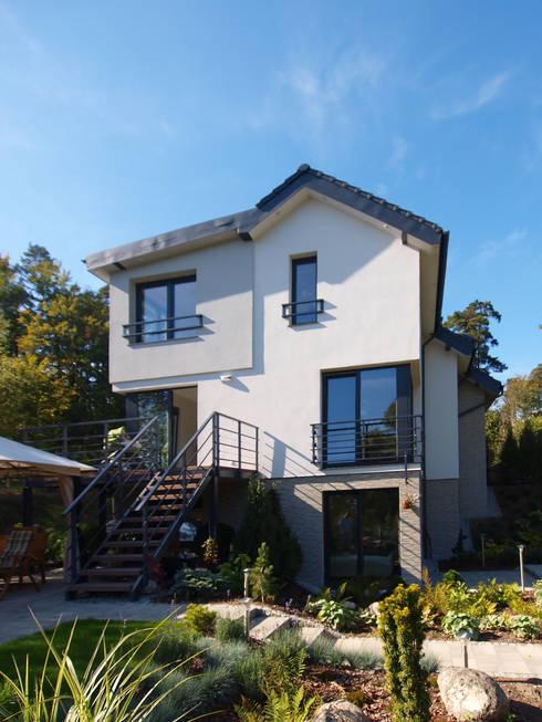 Dom Babidół: styl , w kategorii Domy zaprojektowany przez Pracownia Projektowa Wioleta Stanisławska