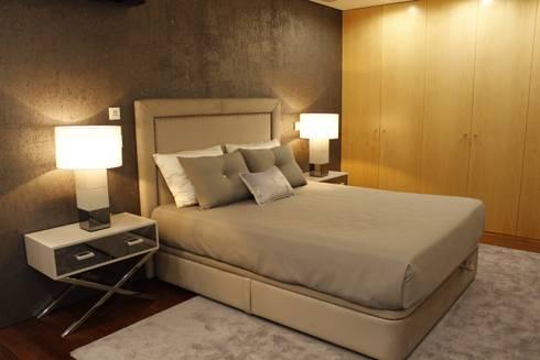 Home sweet home: Quartos modernos por Grupo HC