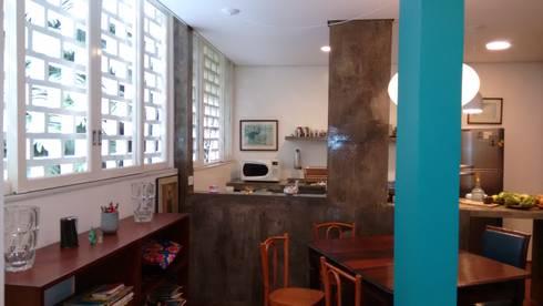 Apartamento duplex: Salas de jantar tropicais por Bloch Arquitetos Associados
