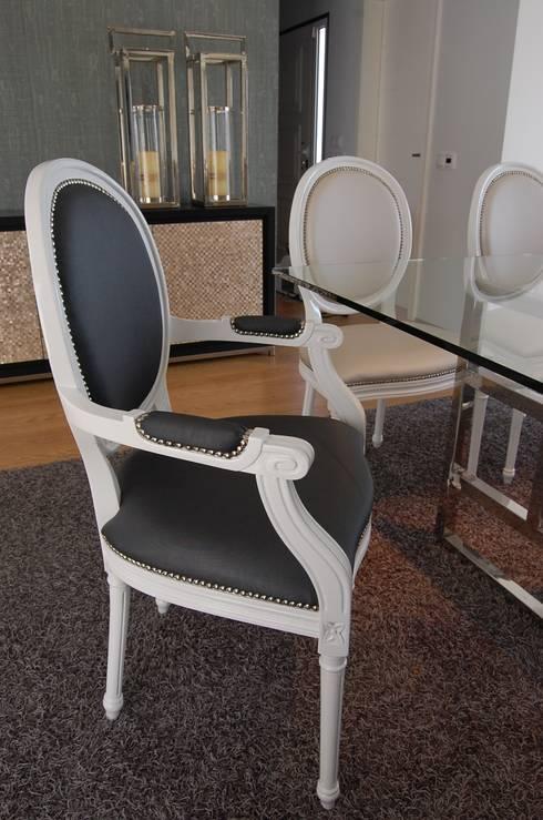 Moradia familiar : Salas de jantar ecléticas por Critério Arquitectos by Canteiro de Sousa