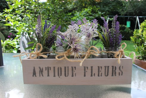 Arreglos para Flores: Hogar de estilo  por Punto&Casa