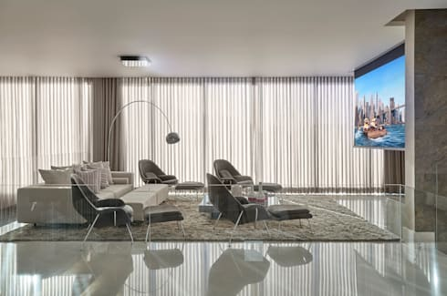 Residência Condomínio Hibisco: Salas multimídia clássicas por Estela Netto Arquitetura e Design