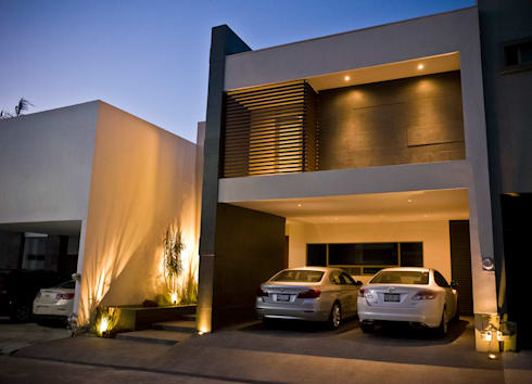 Fachada principal: Casas de estilo moderno por fc3arquitectura