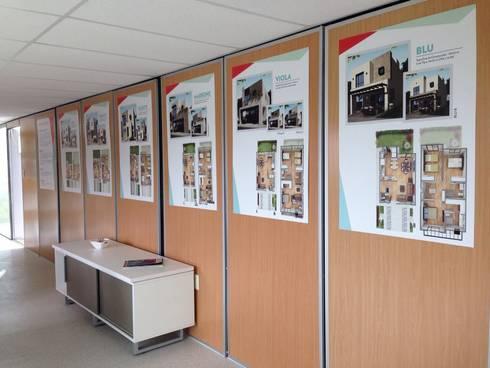 Exhibición : Oficinas y tiendas de estilo  por Xarzamora Diseño