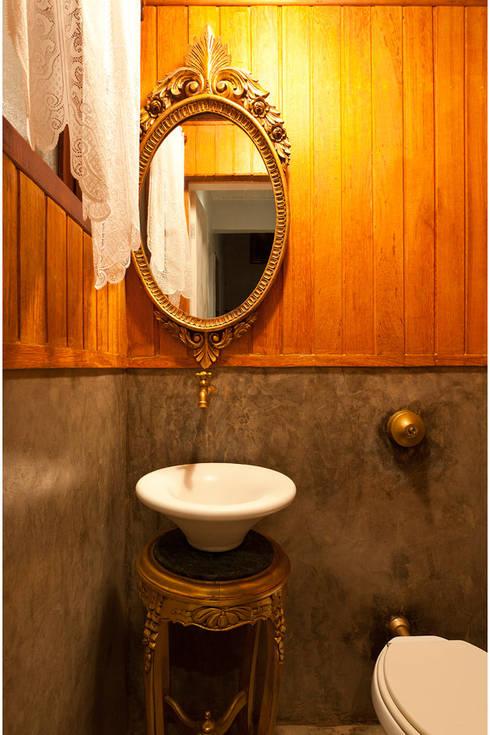 Baños de estilo  por MMMundim Arquitetura e Interiores