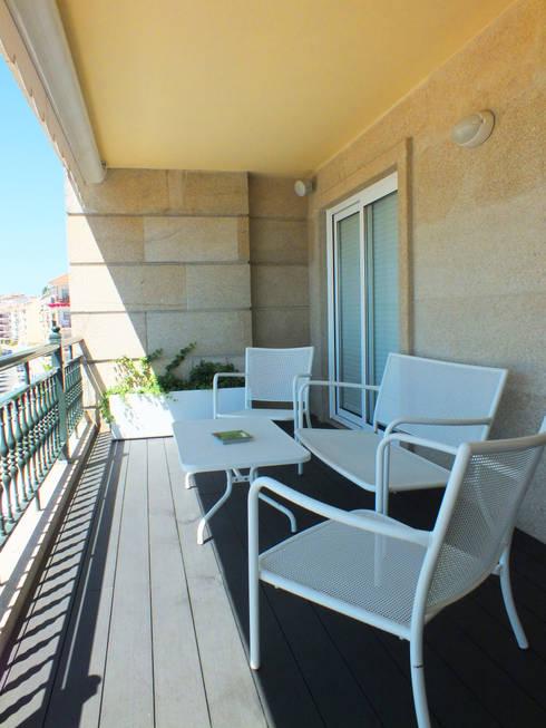 Apartamento de vacaciones en Sanxenxo, Galicia.: Terrazas de estilo  de Oito Interiores