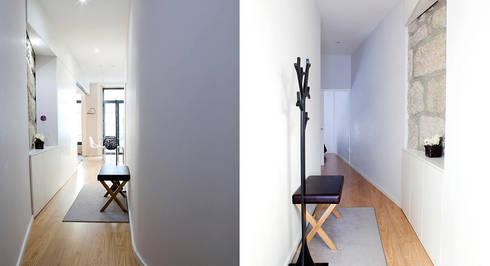Edifício habitacional: Corredores e halls de entrada  por Alves Dias arquitetos
