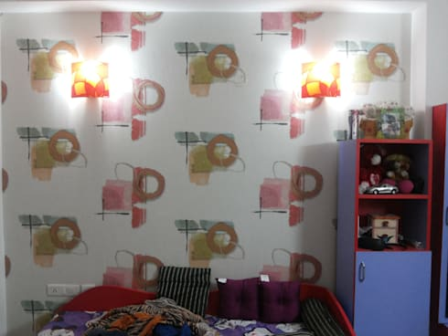 Ajnara Residential Apartment.: tropical Bedroom by Decor At Door