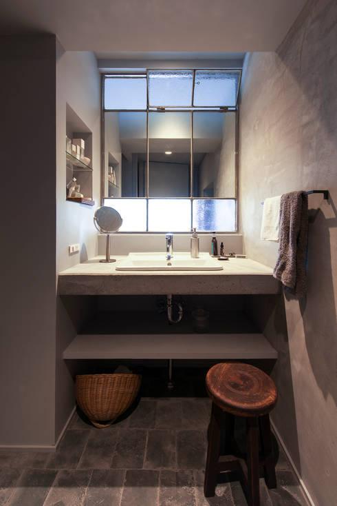星ヶ丘のリノベーション: Nobuyoshi Hayashiが手掛けた浴室です。
