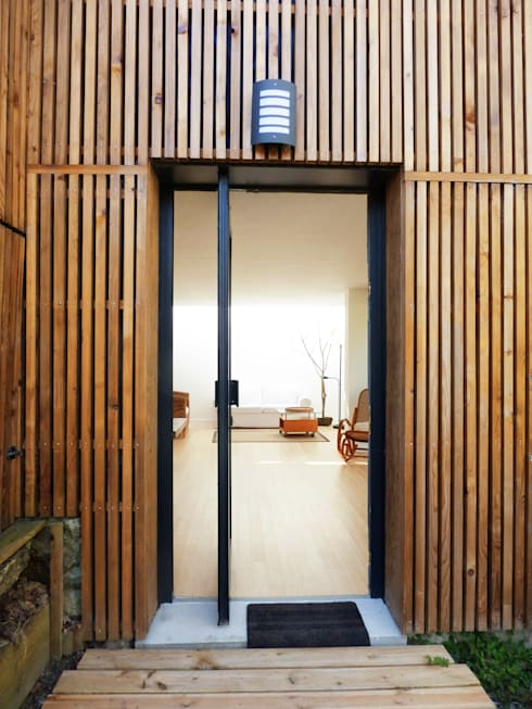 Un Loft à l'Orée du Bois: Maisons de style de style Minimaliste par AADD+